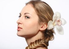 Free Portrait Of The Young Blond Girl With Orchid Royalty Free Stock Images - 18481859