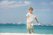 Free Boy Running On Sea Background Royalty Free Stock Image - 18482076