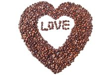 Heart From Brown Coffee Beans And Word Of Love Royalty Free Stock Image