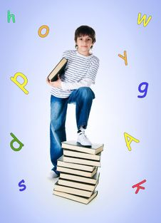 Free Cute Little Boy Near The Stack Of Big Books Royalty Free Stock Photos - 18483458