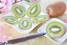 Free Kiwi Slices On White Plates And Knife Royalty Free Stock Photos - 18485338