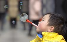 Free Child Blowing Soap Bubbles Stock Image - 18485791