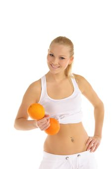 Free Woman Engaged In Fitness Dumbbells Of Oranges Royalty Free Stock Photo - 18486685
