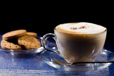 Free Cappuccino On Blue Glass Table Stock Image - 18488201
