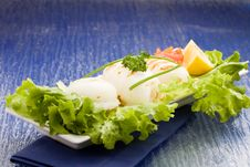Free Squid With Lettuce On Blue Glasstable Royalty Free Stock Photos - 18489968