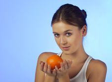 Free The Woman With An Orange Fruit Royalty Free Stock Images - 18489979