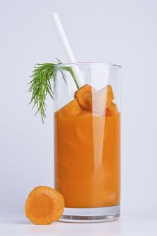 Glass With Slices Of A Carrot And Carrot Juice