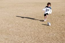 Free Football Chasing Boy Stock Photography - 1853602