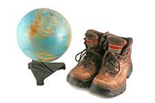Brown Boot Next To A Rotating Globe Stock Photos