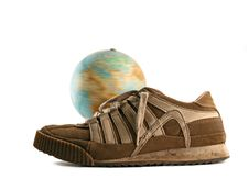 Sport Shoes Next To A Globe Royalty Free Stock Photography