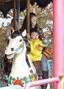 Free Baby Riding Merry Go Round Royalty Free Stock Photos - 18502548