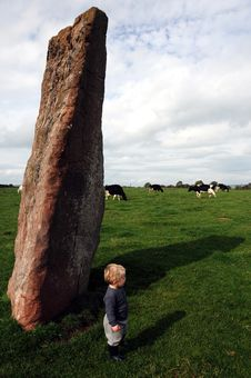 Free Young Boy Beside Druid S Stone Stock Image - 18501081