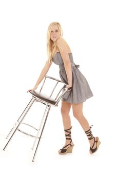 Free Woman Gray Dress Tipping Stool Stock Photos - 18501113