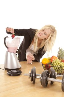 Woman Putting Strawberry In Blender Stock Photography