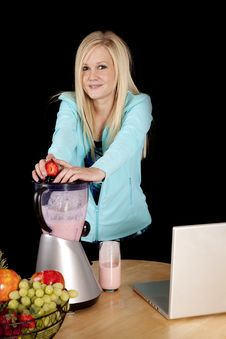 Woman With Blender And Strawberry Royalty Free Stock Photo