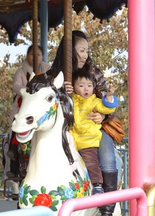 Free Baby Riding Merry Go Round Royalty Free Stock Photos - 18502548