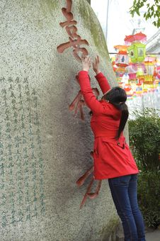Free A Woman Praying On A Stele In Temple Stock Photos - 18502703
