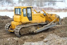 Free A Yellow Bulldozer Working In The Winter Stock Photo - 18504340