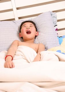 Free Laughing Boy On Bed Royalty Free Stock Photography - 18505697