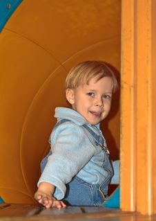 Boy In Tube Slide Royalty Free Stock Image