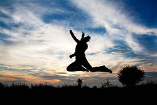 Free Girl Jumping In Front Of Beautiful Sunset Royalty Free Stock Images - 18506539