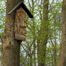Wooden Sculpture On The Tree Stock Image