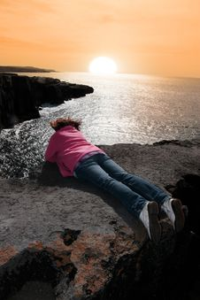 Lone Woman On Cliffs Edge Royalty Free Stock Photography