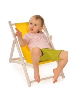 Free Funny Little Girl In Studio On Yellow Deckchair Royalty Free Stock Images - 18506989