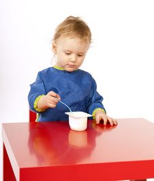 Free Little Baby Is Eating On Red Table Royalty Free Stock Photography - 18507047