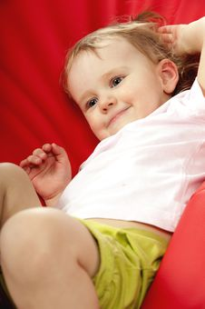 Free Little Baby On Red Background In Studio Stock Image - 18507181