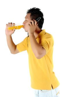 Free A Young Man Was Drinking A Bottle Of Orange Juice Royalty Free Stock Photo - 18508875