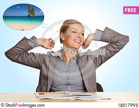Businesswoman bored in office Stock Photo