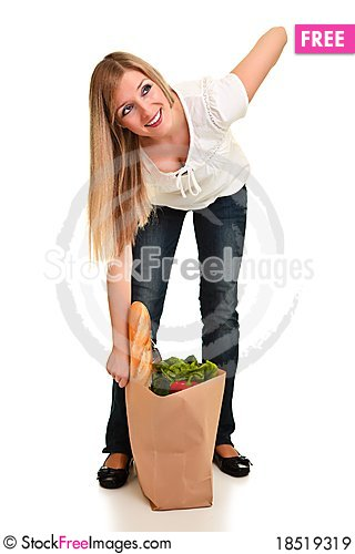 Woman carrying bag of groceries Stock Photo