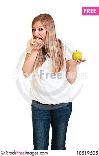 Woman choosing apple over puff Stock Photo