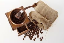 Coffee Mill With Burlap Sack Of Roasted Beans Royalty Free Stock Images