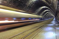 A Train Disappearing Into A Tunnel Royalty Free Stock Photos