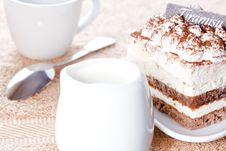 Portion Of Tiramisu Dessert And A Cup Of Coffee Royalty Free Stock Photos