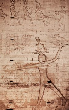 Egyptian Images And Hieroglyphs Engraved On Stone Stock Photos