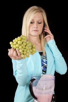 Woman On Phone With Grapes Royalty Free Stock Photo