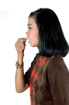 Young Woman Was Eating A Pill Capsule Stock Photos