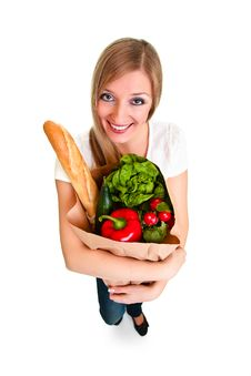 Free Woman Carrying Bag Of Groceries Royalty Free Stock Photo - 18519375