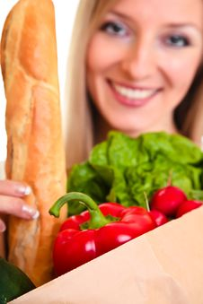 Free Woman Carrying Bag Of Groceries Stock Image - 18519391