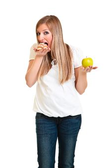 Free Woman Choosing Apple Over Puff Royalty Free Stock Photo - 18519505