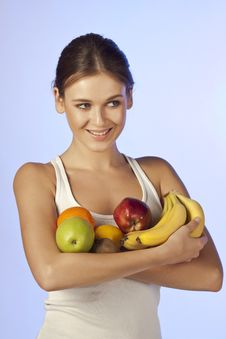 Free Young Beautiful Brunette Is Holding Fruit Stock Photography - 18519912