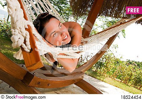 Young woman in hammock Stock Photo