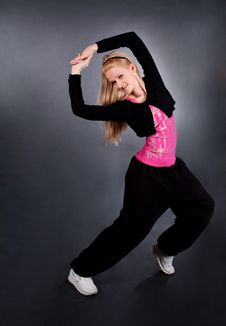 Modern Style Dancer Posing Over Grey Royalty Free Stock Photography