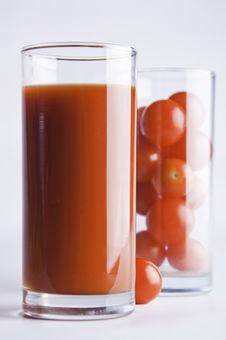 Glasses With Tomato Juice And Cherry Tomatoes Royalty Free Stock Photos