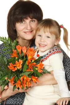 Grandmother And Granddaughter With Bunch Of Flower Stock Photography