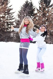 Girls Ice Skating Stock Photography