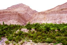 Red Mountain And Green Trees Stock Photo